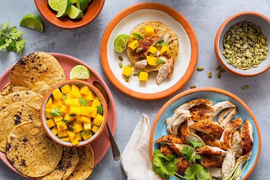 Smoky shredded-chicken tacos with mango salsa