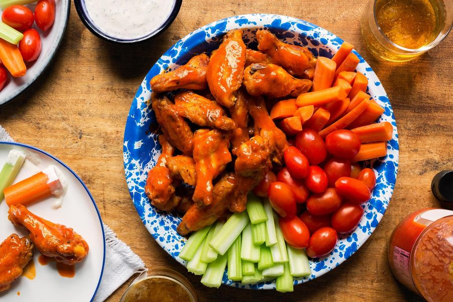 Buffalo chicken wings with crunchy vegetables and ranch dressing