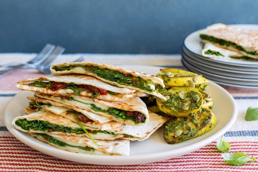 Spinach-mozzarella panini with seared summer squash and arugula pesto