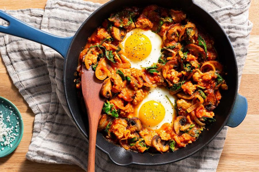 Eggs in purgatory on spicy turkey, mushroom, and kale hash