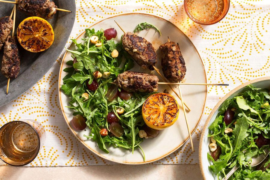 Greek souzoukaklia beef skewers with arugula-grape salad