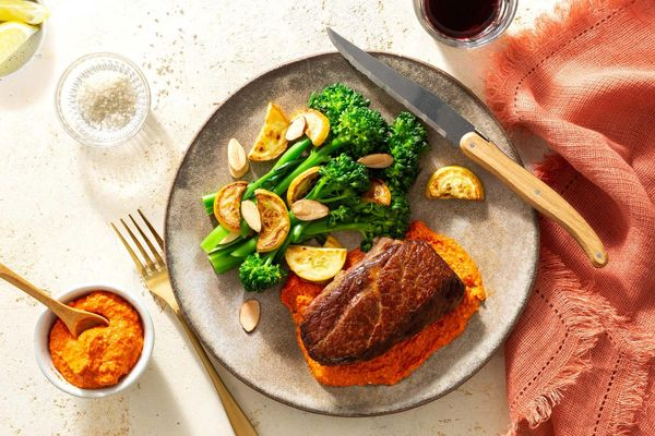 Steaks and romesco with baby broccoli, squash, and almonds