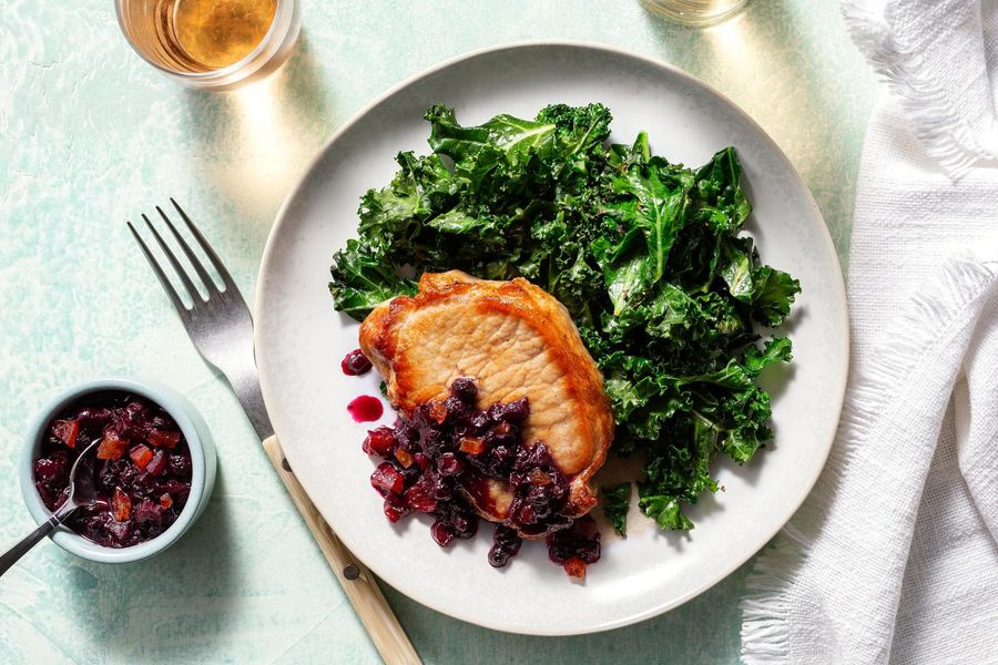 Blueberry-apricot pork chops with sautéed kale