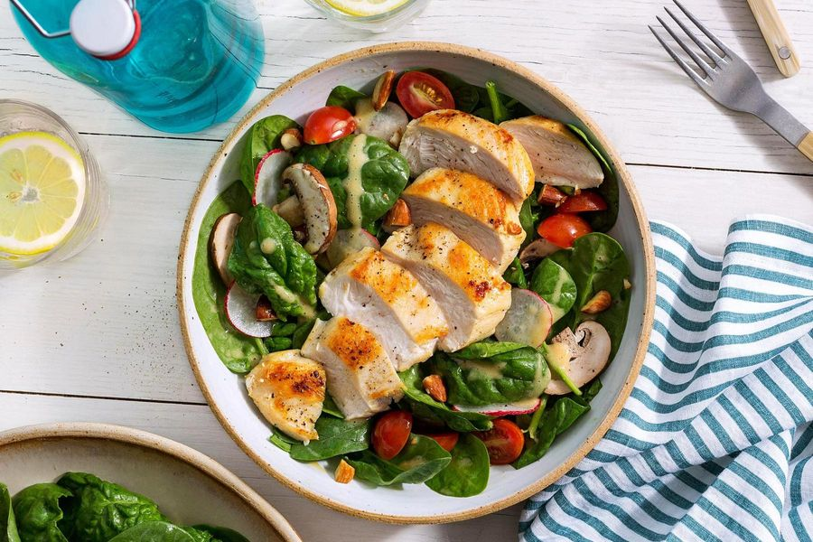 Spinach salad with chicken, roasted almonds, and honey-mustard vinaigrette