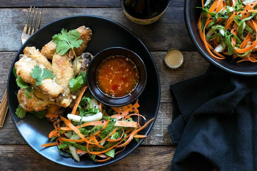 Shanghai chicken wings with ginger-chile dipping sauce and bok choy slaw