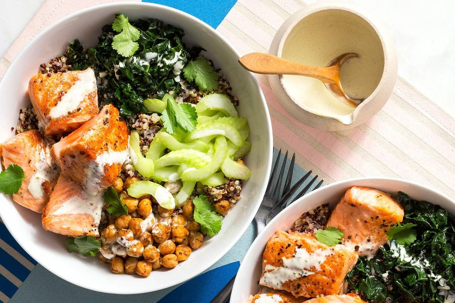 Citrusy quinoa bowls with salmon and wilted greens
