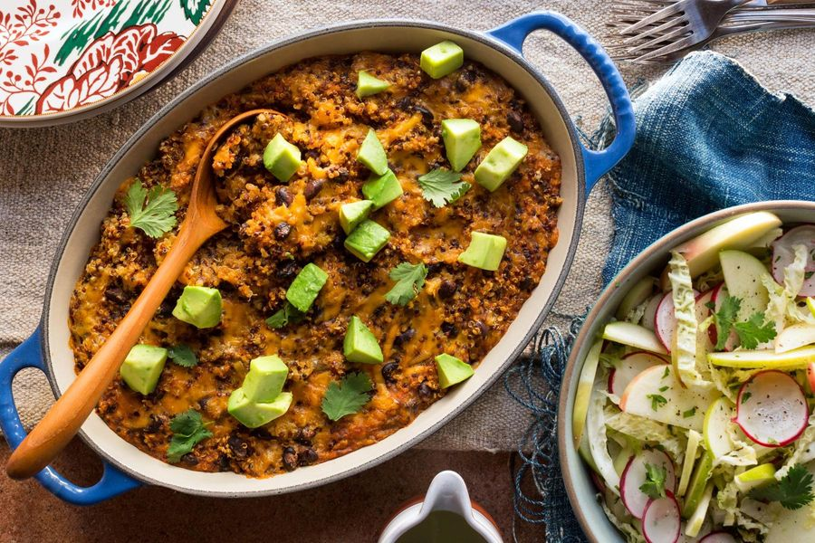 Quinoa and black bean enchilada casserole with radish-apple salad