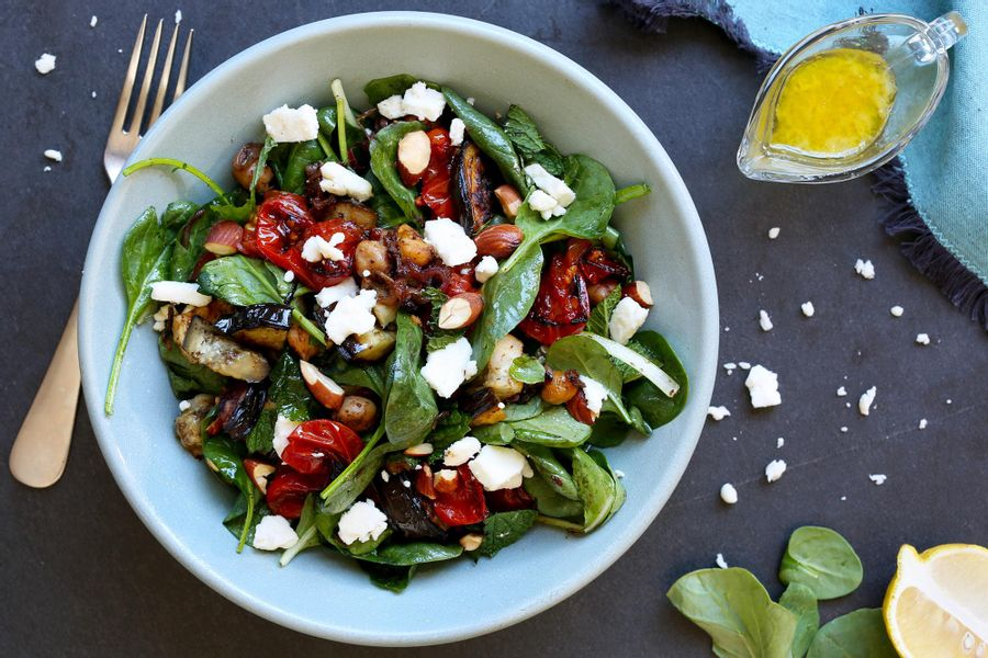 Spinach salad with grilled eggplant, roasted tomatoes and chickpeas