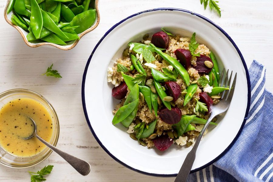 Quinoa bowls with snap peas, beets, feta, and mint