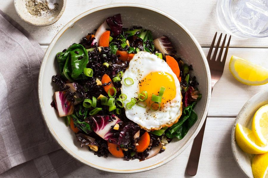 Superfood stir-fry with bok choy, black rice, and fried eggs