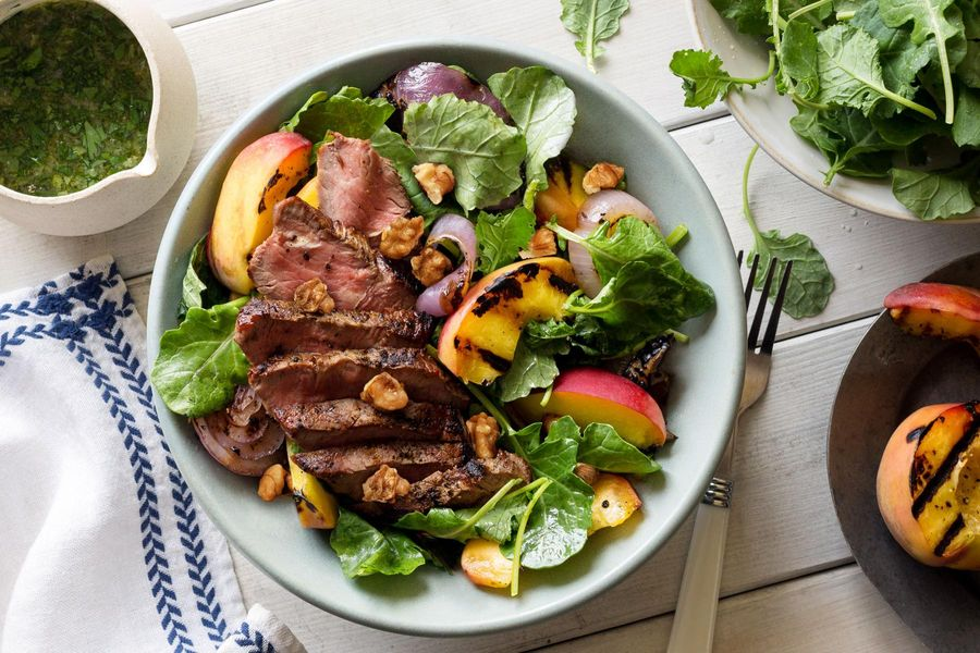 Steak and stone fruit salad with walnuts and ginger-basil dressing