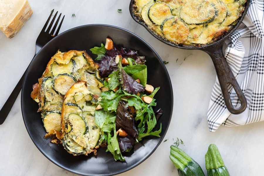 Zucchini and ricotta torta with mixed greens