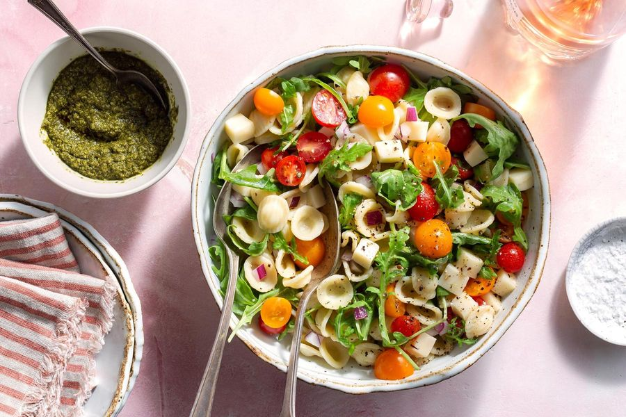 Caprese orecchiette with cherry tomatoes and basil pesto