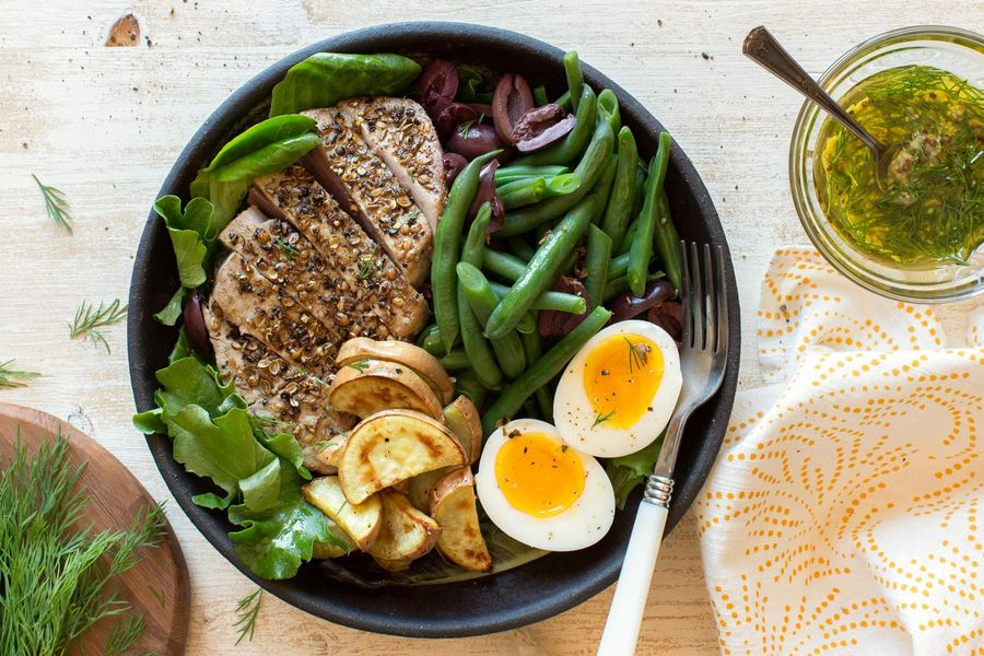 Seared albacore tuna steaks with green beans and soft-cooked eggs