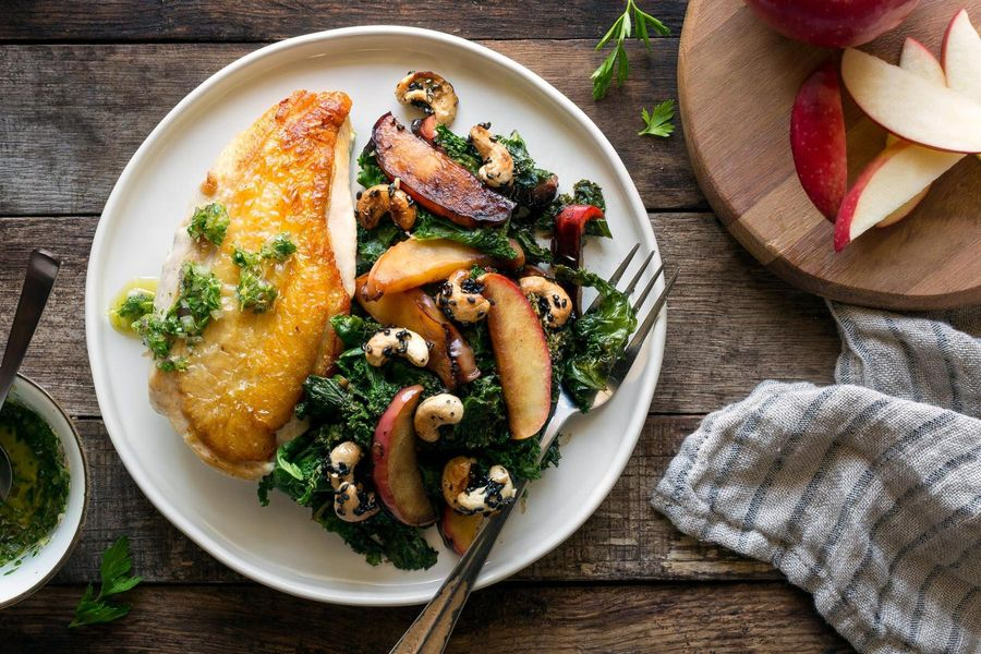 Roasted chicken breasts with sautéed kale and apples
