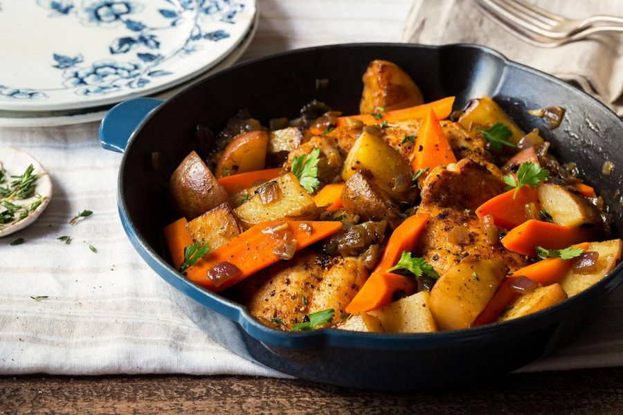Braised chicken with carrots, potatoes, and thyme