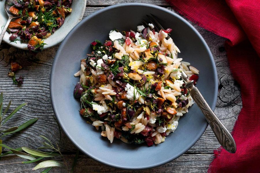 Gluten-free orzo bowl with chard and olive-almond relish