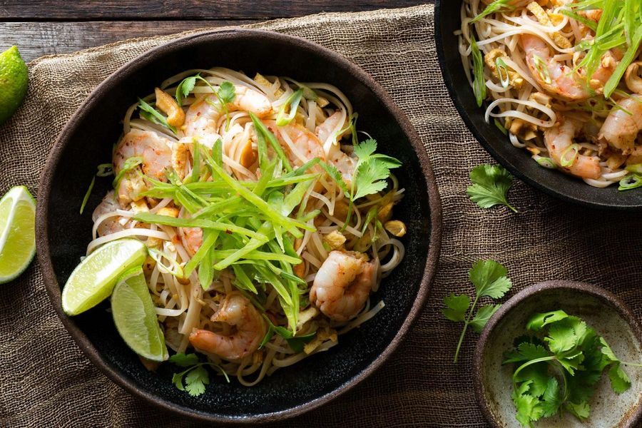 Shrimp pad thai with rice noodles and sugar snap peas