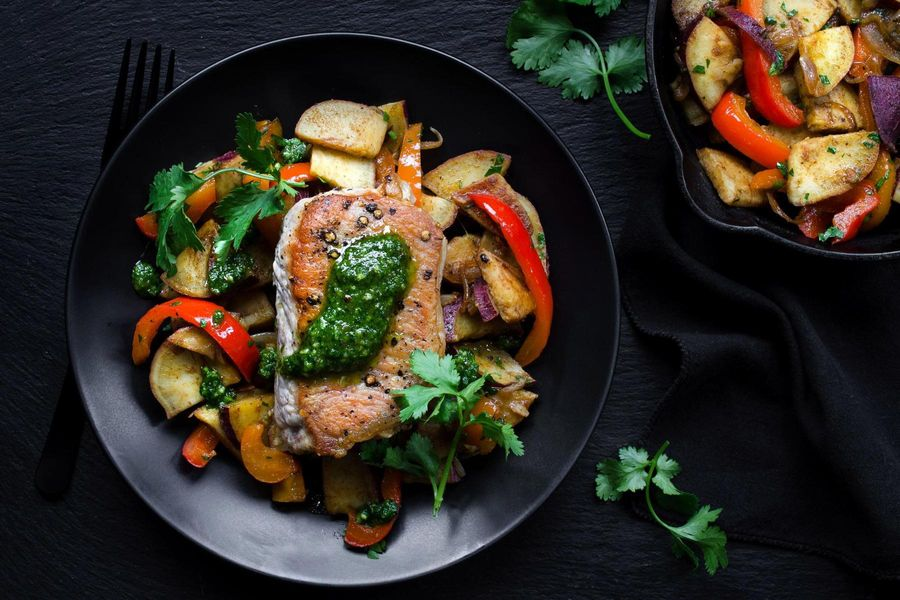 Roasted pork chops with sweet potato hash and cilantro pesto