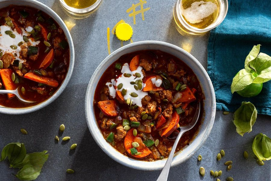 Spicy chorizo and tomatillo chili with sweet potato and pumpkin seeds