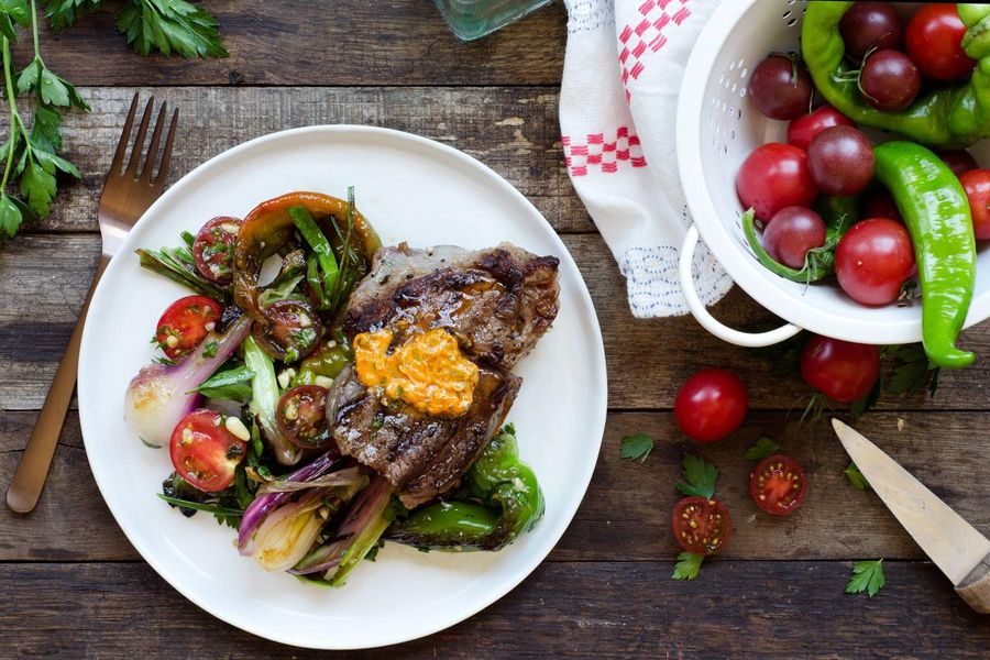 Steaks with paprika butter, pan-charred vegetables, and gremolata