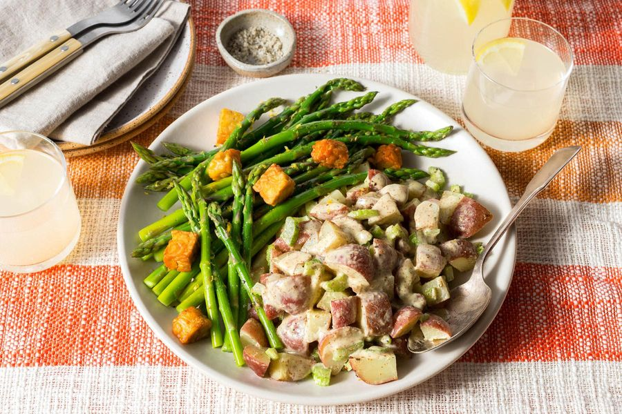 Warm potato salad with roasted asparagus, mustard vinaigrette, and tempeh croutons