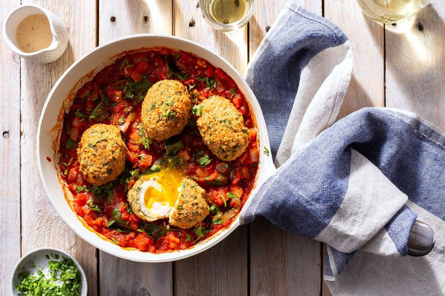 "Spicy shakshuka with falafel ""Scotch"" eggs and lemon-tahini sauce"