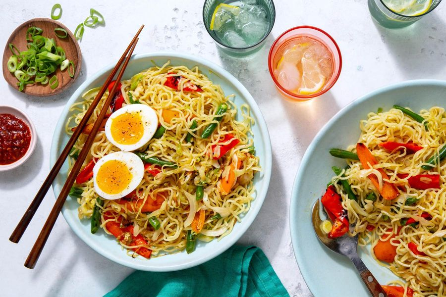 Hakka noodles with stir-fried vegetables and soft-cooked eggs