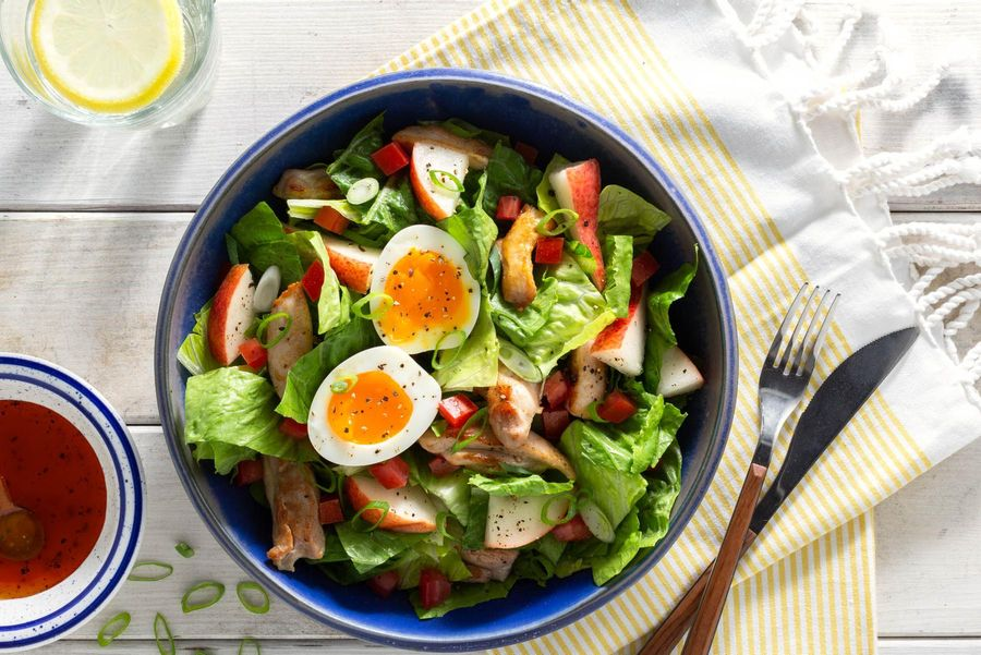 Green salad with chicken, pear, and soft-cooked eggs