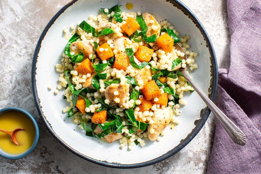 Couscous salad with chicken, butternut squash, and broccoli leaves