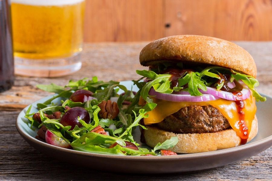 Memphis BBQ cheeseburgers with grape, pecan, and Arugula salad