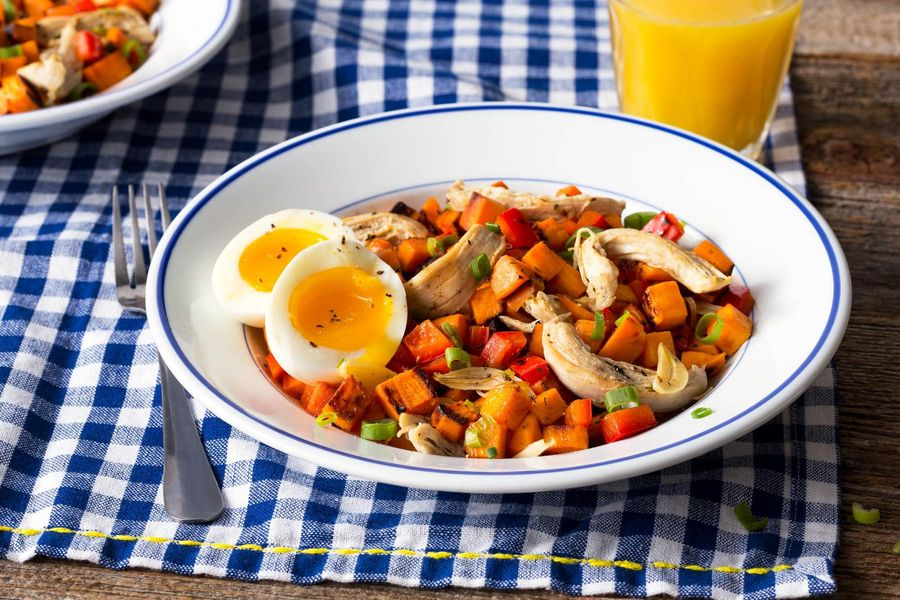 Shredded chicken and sweet potato hash with soft-cooked eggs