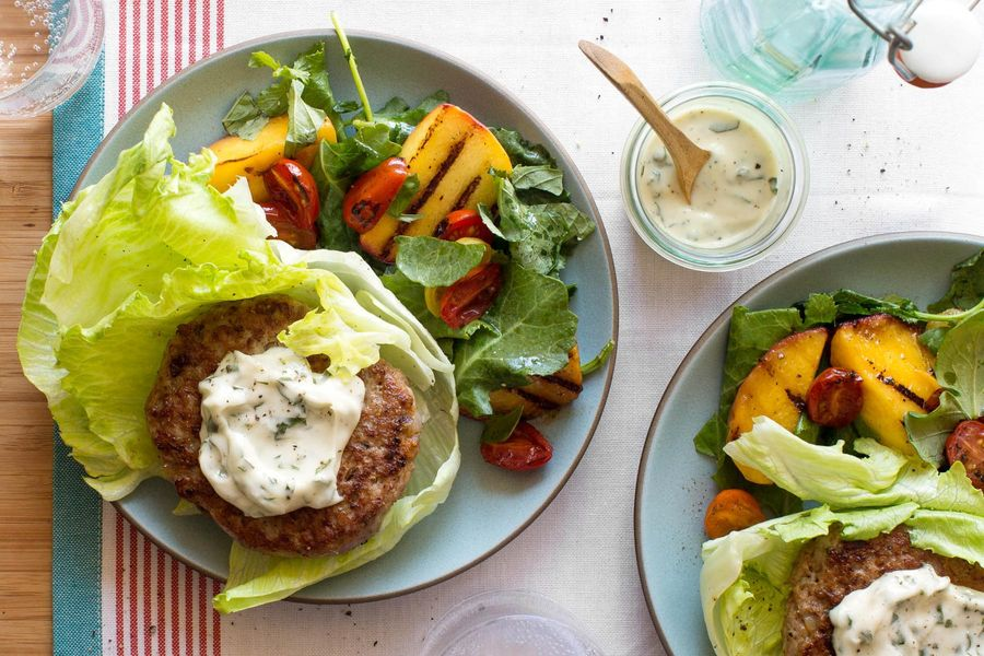 Lettuce-wrapped turkey burgers with grilled peach salad and basil mayo