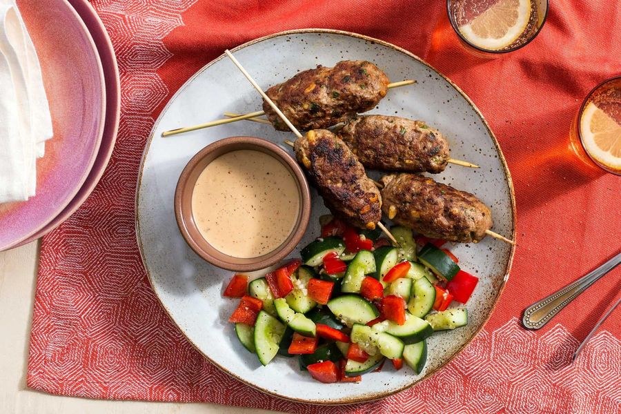 Turkish lamb köfte with tahini sauce and smashed cucumber salad