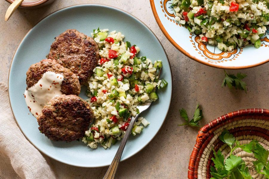 Spiced lamb patties with cauliflower tabbouleh and tahini dressing