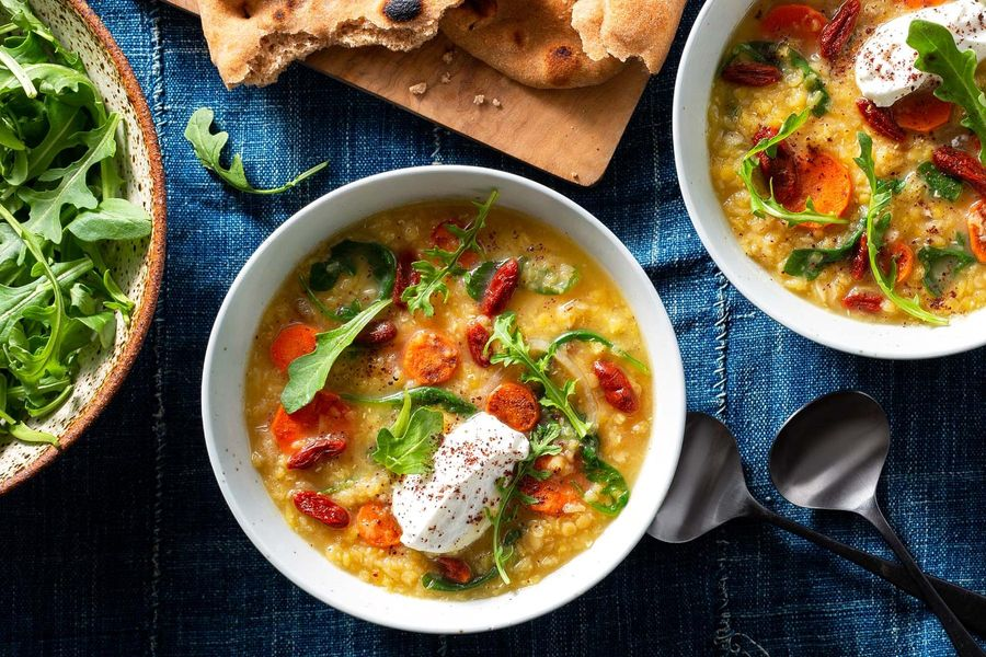 Red lentil–carrot soup with arugula and toasted naan