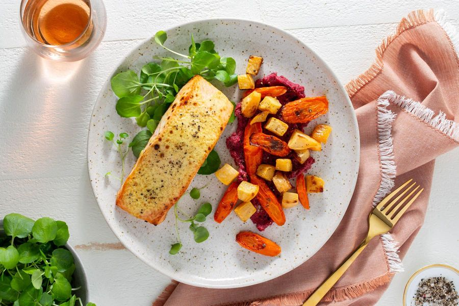 Orange-glazed salmon with root vegetables and cashew-beet smear