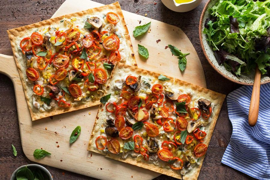 White bean-ricotta pizzettas with tomato and basil