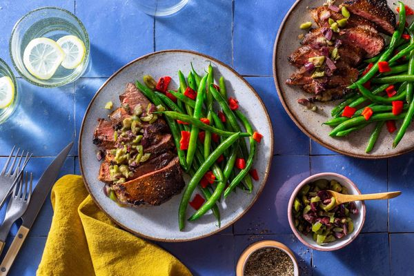 French Quarter–style Black Angus rib-eye steaks with olive tapenade