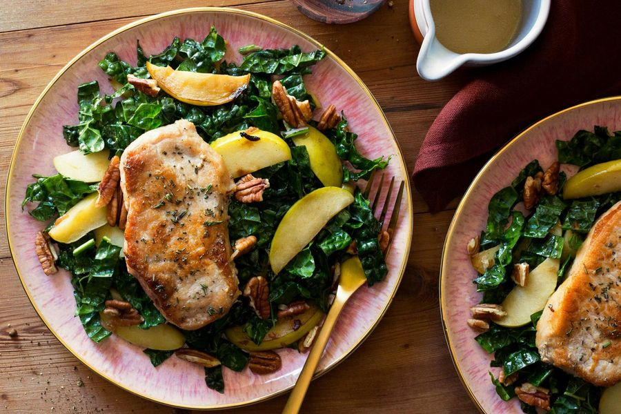 Herb-crusted pork chops with kale and apple salad