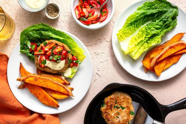 Lettuce-wrapped turkey burgers with tomato relish and sweet potato fries