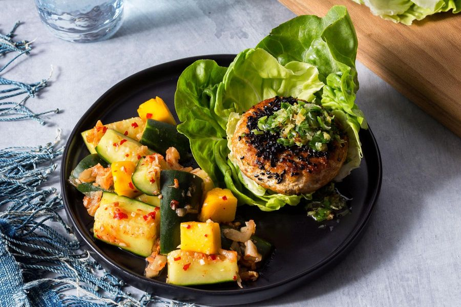 Lettuce-wrapped salmon burgers with cucumber-kimchi smash