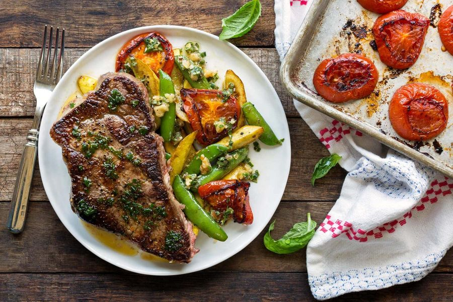 Seared steak with charred tomatoes and basil-walnut dressing