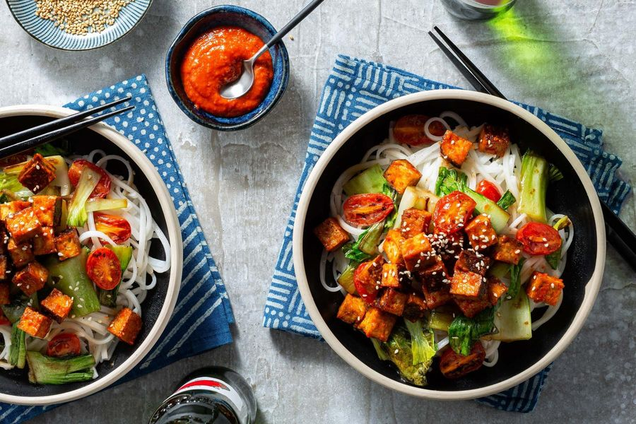 Five-spice tofu stir-fry with flat rice noodles, tomatoes, and bok choy