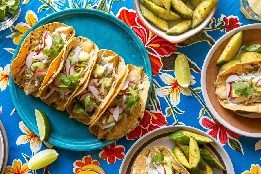 Fish tacos with avocado and Baja cucumber salad