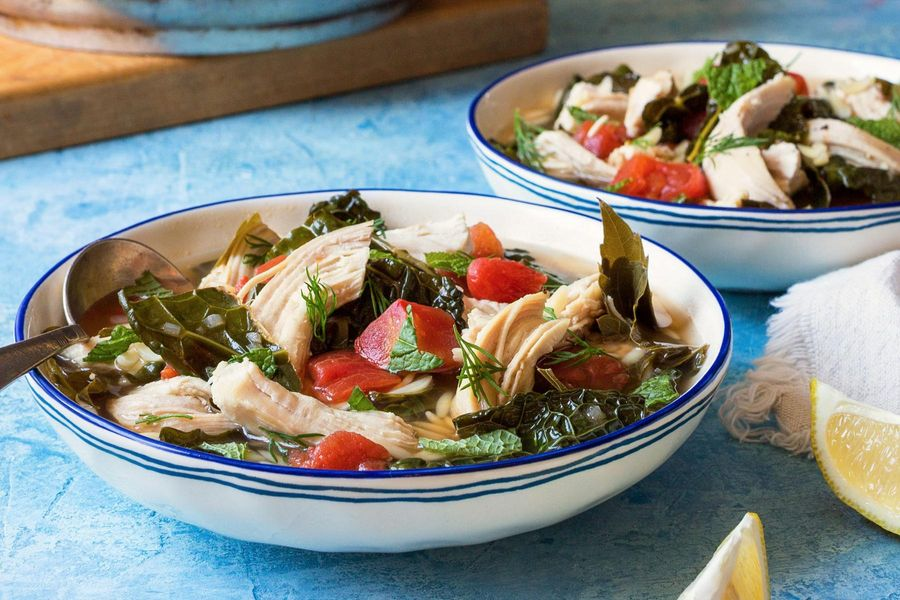 Greek lemon chicken soup with gluten-free orzo and grape leaves