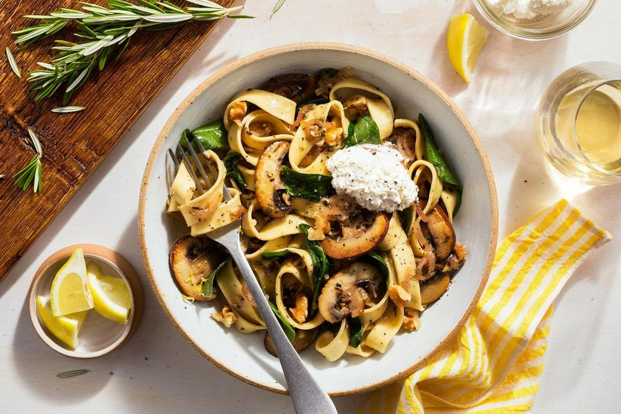 Fresh pappardelle with cremini mushrooms, spinach, and ricotta