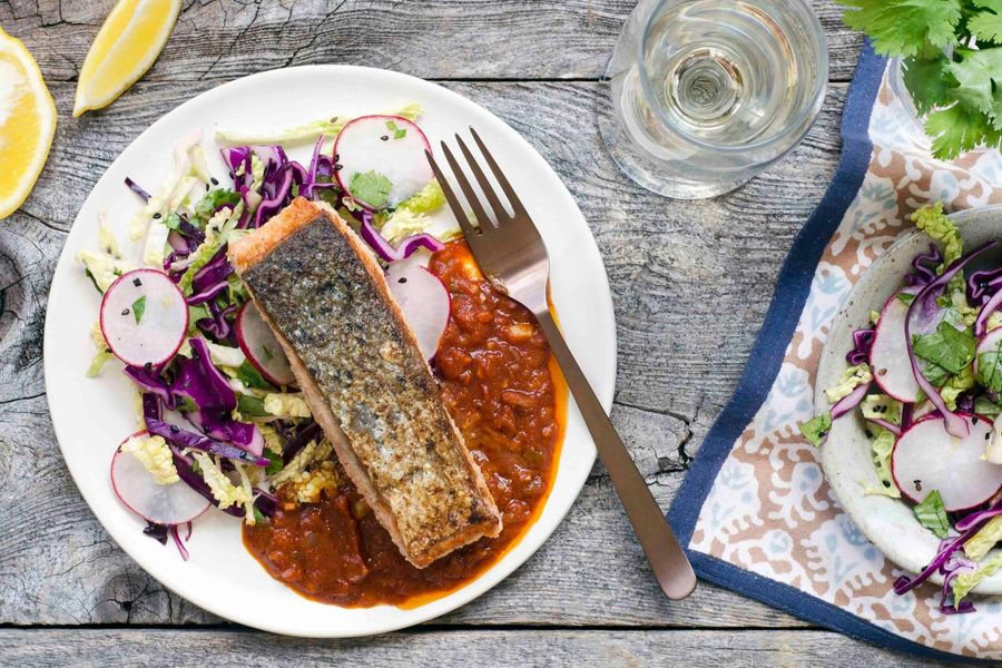 Seared salmon in charaimeh sauce with cabbage slaw
