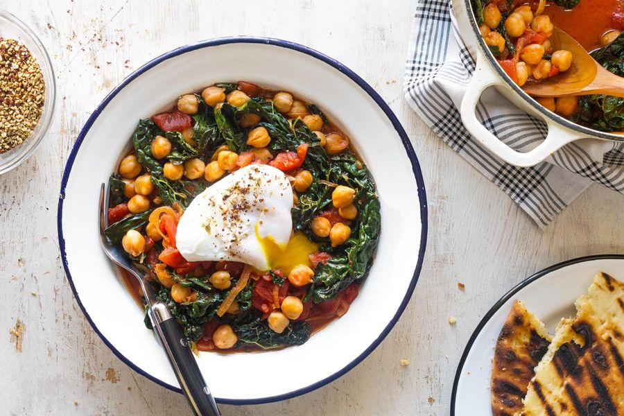 Chickpea and kale stew with poached eggs and za'atar