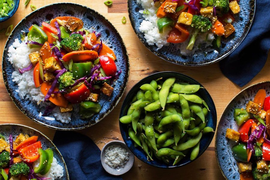 Orange-glazed tofu with bell peppers, broccoli, and jasmine rice